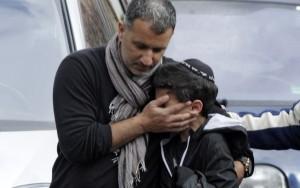 Aluno em frente a escola judaica atacada em Toulouse, França, 2012